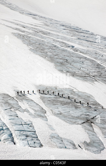 Hikers on Juklavassbreen, Folgefonna glacier, Western Norway - Stock Image