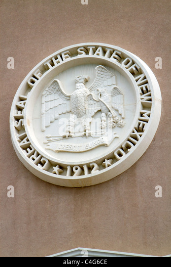 Stone carving of the State Seal on the New Mexico State Capitol building located in Santa Fe, New Mexico, USA. - Stock Image