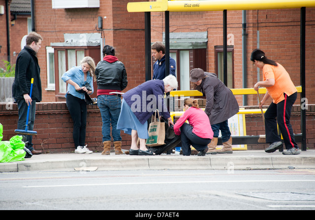 Residents cleaning streets after riot Liverpool - Stock Image