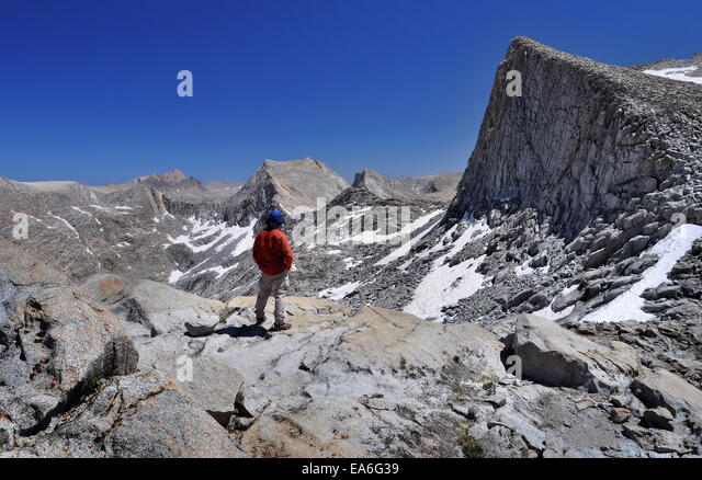 USA, California, Sierra Nevada Range, Hiker on Top of Seven Gables Pass - Stock Image