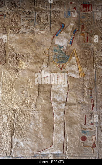 Osiris. Polychrome limestone reliefs from the Temple of Hatshepsut. Deir El-Bahari. Egypt. - Stock Image