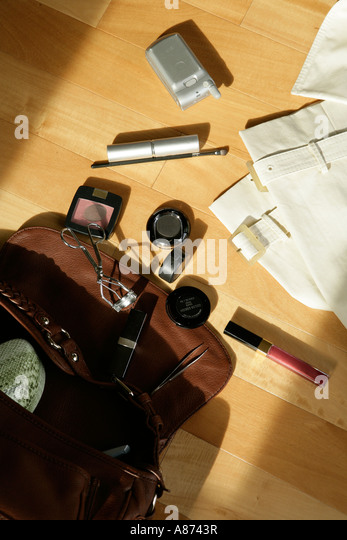 Handbag with makeup articles, elevated view - Stock Image