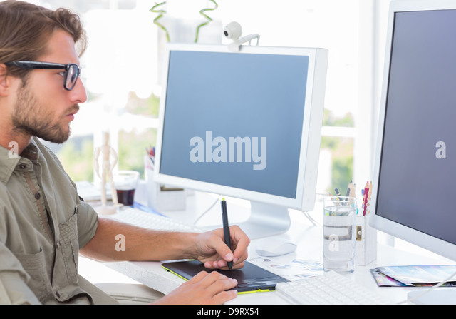 Graphic designer using graphics tablet - Stock-Bilder