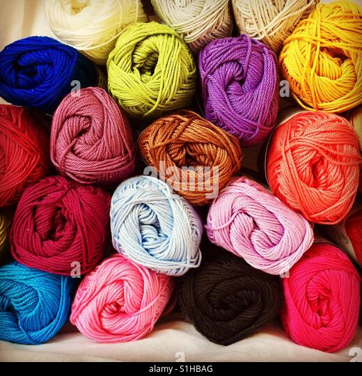 Little balls of crochet yarn in different colours - Stock Image