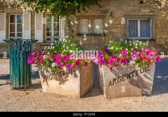Pre-cast concrete planters with town name, Yonne, France. - Stock Image