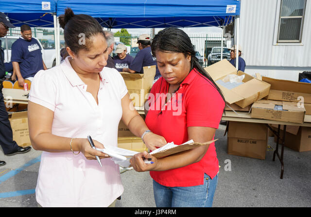 Miami Florida Little Haiti Thanksgiving Turkey Give-Away give away volunteers Black Haitian organizer supervisor - Stock Image