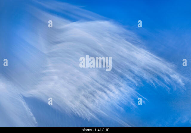 Blue skyscape with unusual Cirrus clouds - France. - Stock Image