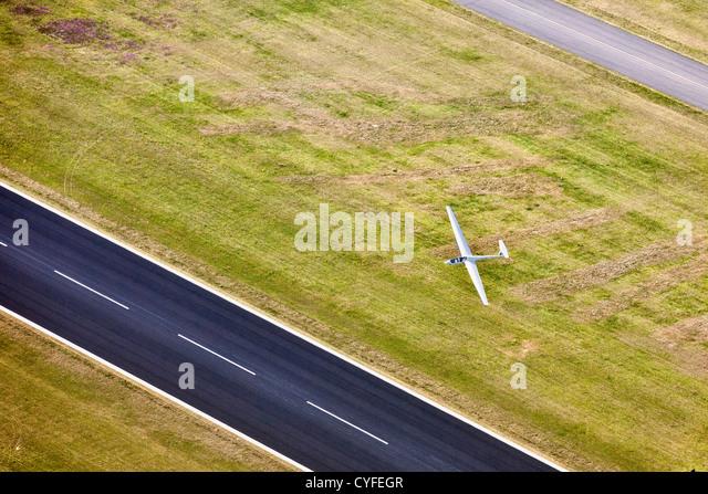 The Netherlands, Hoogerheide, Airport Woensdrecht. Glider passing airstrip. Aerial. - Stock Image