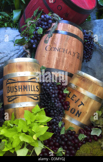 Wine barrel and grape display. - Stock Image
