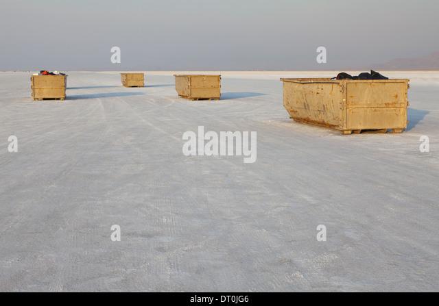 Bonneville Salt Flats Utah USA Large garbage containers on salt flats dusk - Stock Image