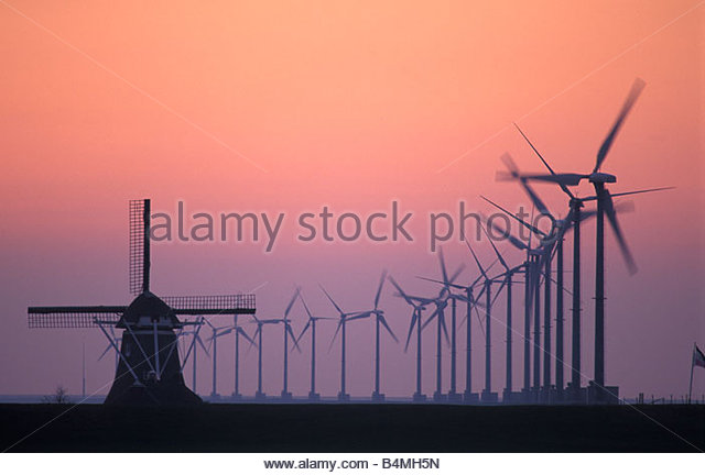 Holland The Netherlands Eemshaven Wind park Eemsmond with 134 wind turbines Background ancient windmill watermill - Stock Image