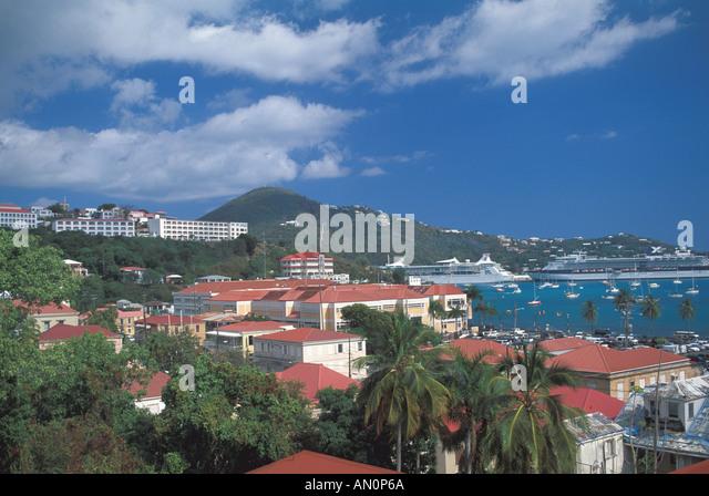 St Thomas USVI  charlotte amalie  cruise ship port sailboats hillside red roofs - Stock Image