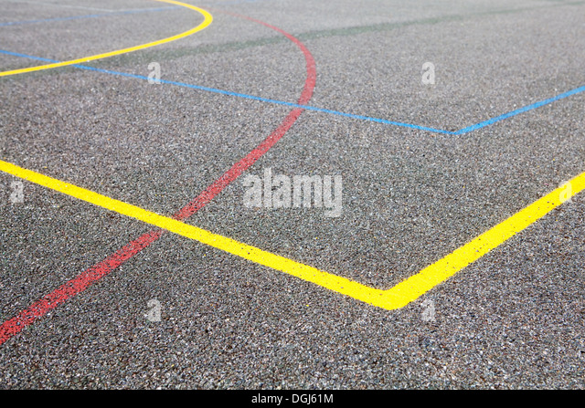 Coloured lines on basketball court - Stock Image