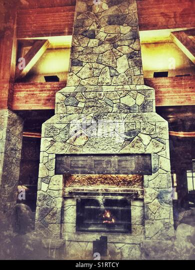 Stone fireplace stock photos stone fireplace stock for Area in front of fireplace