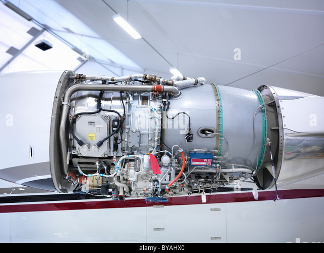 Jet engine in an aircraft hangar - Stock Image