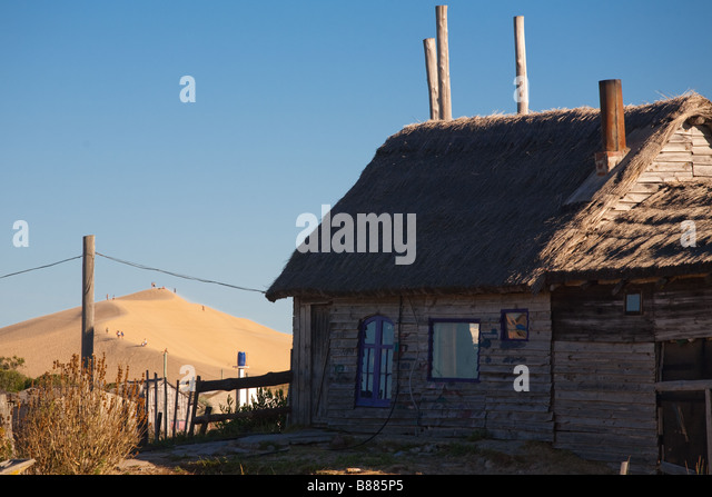Typical Valizas shack with the dunes at the back - Stock Image