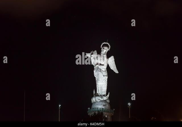 Virgin of Quito Madonna statue in aluminium panels on El Panecillo hill illuminated at night, Quito, capital city - Stock Image