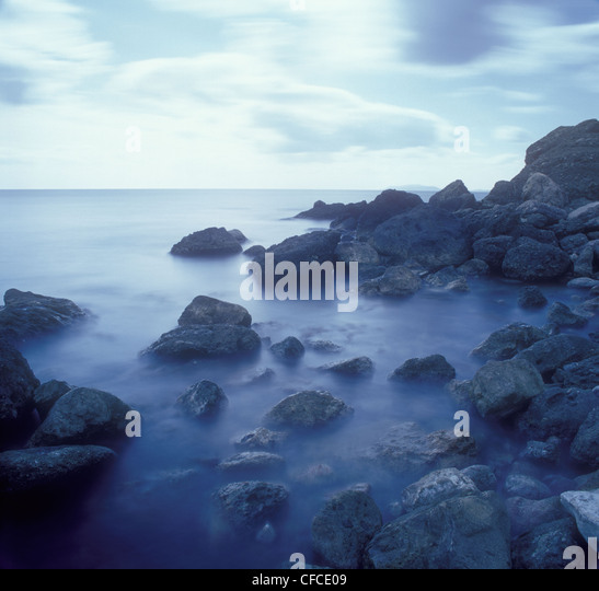 Stones in the surf. - Stock Image