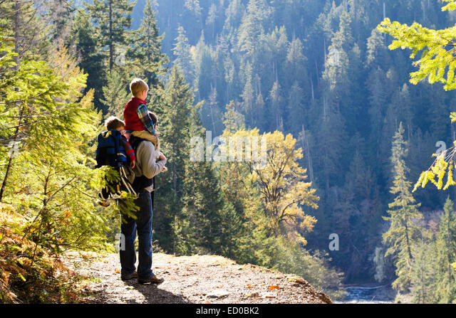 USA, Washington State, Father and two boys (2-3, 4-5) hiking in mountains - Stock Image