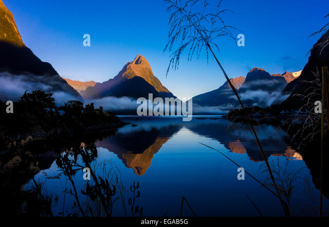 New Zealand Milford Sound with Mitre Peak in Fiordland National Park New Zealand at dawn - Stock Image