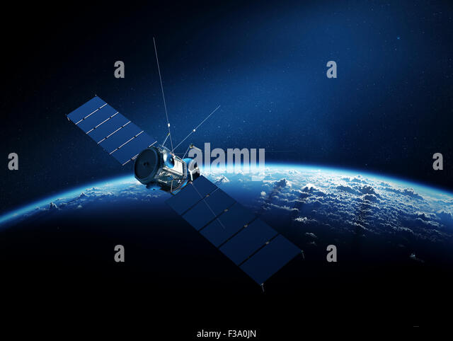 Communications satellite orbiting Earth with sunrise in space - Stock Image