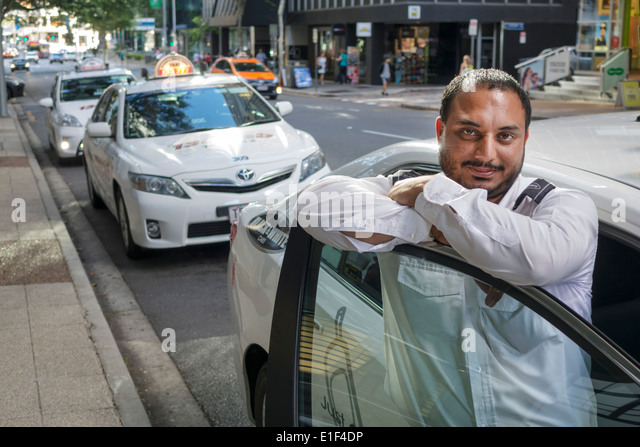 Brisbane Australia Queensland Central Business District CBD Asian Indian man taxi cab driver immigrant - Stock Image