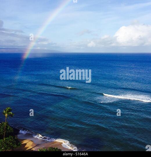 Rainbow over the pacific ocean. Kāʻanapali, Maui Hawaii. - Stock Image