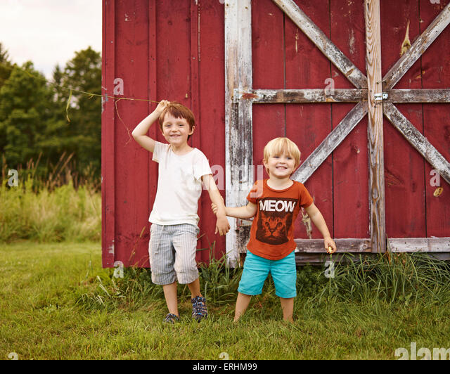 Two boys playing in a garden - Stock Image
