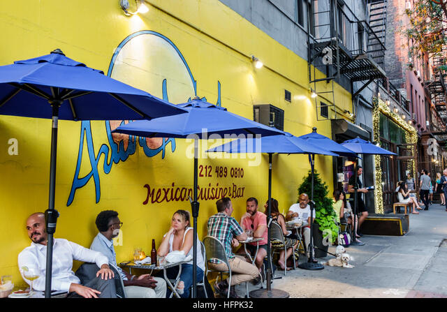 New York New York City NYC Manhattan Hell's Kitchen Arriba Arriba Mexican restaurant ethnic food sidewalk table - Stock Image