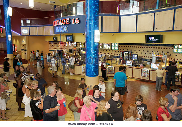 Indiana Portage Portage 16 IMAX movie theater complex lobby ticket line overhead view food concession snacks families - Stock Image