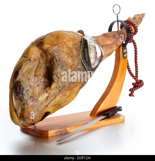 Whole Serrano ham on stand with knife - Stock Image