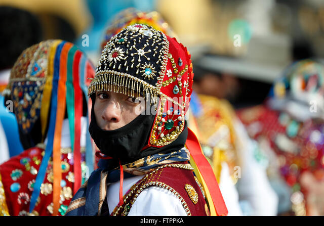 Men in costume celebrating feast of Virgen del Carmen de Paucartambo (Cusco Province), near Plaza de Armas, Lima, - Stock Image
