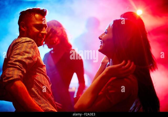 Happy couple at disco - Stock-Bilder