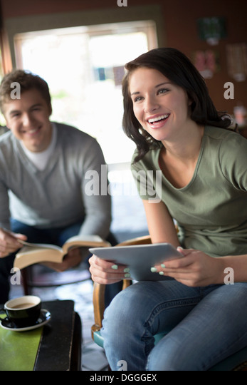 Study group having fun in coffee house - Stock Image