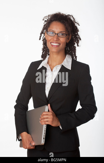 Young businesswoman holding laptop. Vertically framed shot. - Stock Image