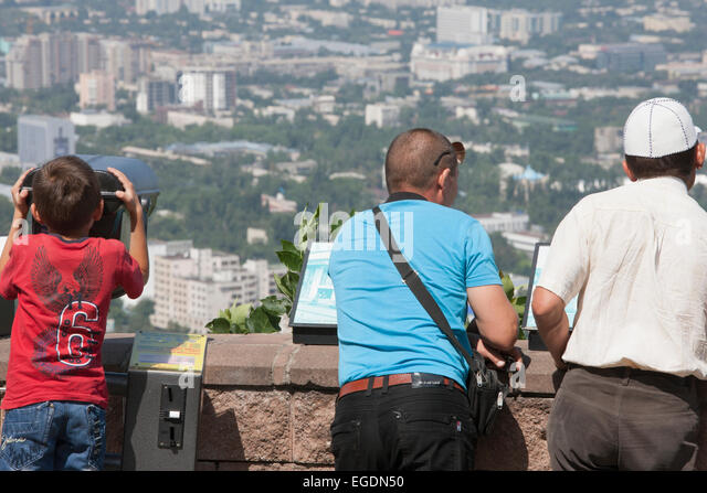 People looking at view of Almaty from Kok Tobe mountain, Almaty, Kazakhstan - Stock Image