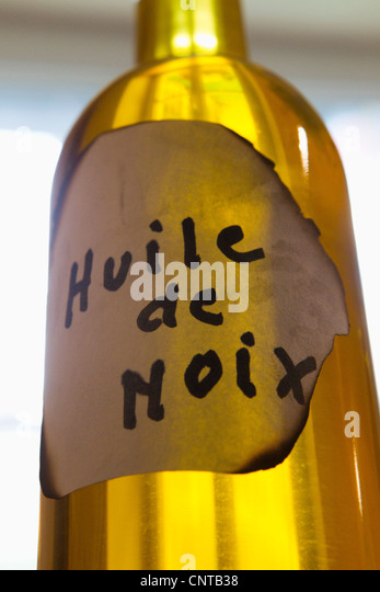 Bottle of walnut oil - Stock Image