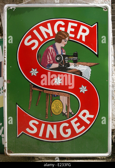 Vintage advertisement for the Singer sewing machines in an antique shop in Cesky Krumlov in South Bohemia, Czech - Stock Image