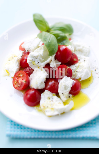 Close up of plate of tomatoes and cheese - Stock Image