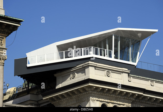 Italy. Milan. Architectural detail of a modern bar terrace atop building near Vittorio Emanuele II Gallery. - Stock Image