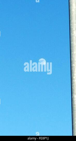 Moon In Clear Blue Sky - Stock Image
