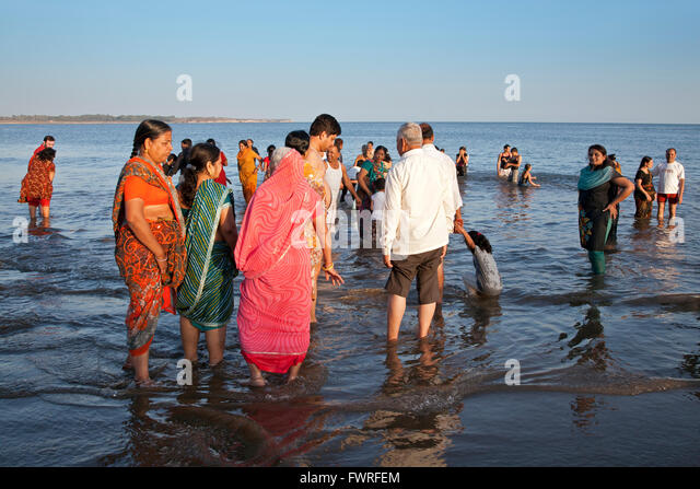 Indian families relaxing at Nagoya Beach. Diu. Union Territories of Daman and Diu. India - Stock Image