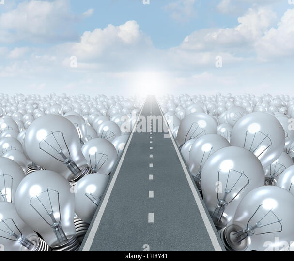 Idea road and creative Path business concept as a street or highway cutting through a landscape of light bulbs as - Stock-Bilder