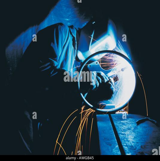 A man welding - Stock Image