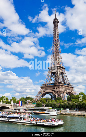Bateaux Mouches tour boat on River Seine passing the Eiffel Tower, Paris, France, Europe - Stock Image
