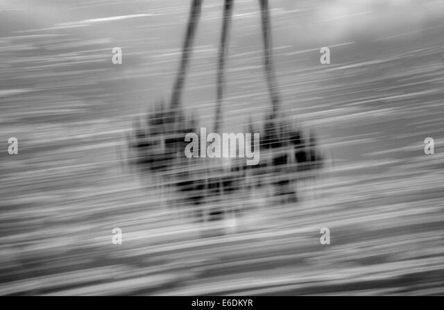 Moving foam pattern on pond with palm tree relfection. Palm Desert, California - Stock Image