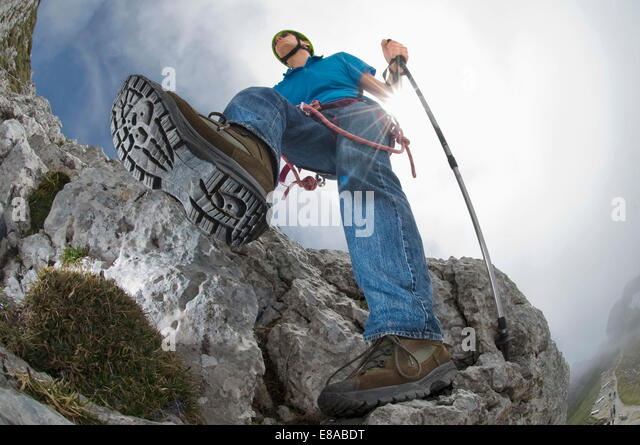 Man climbing mountain alps helmet boots detail - Stock-Bilder