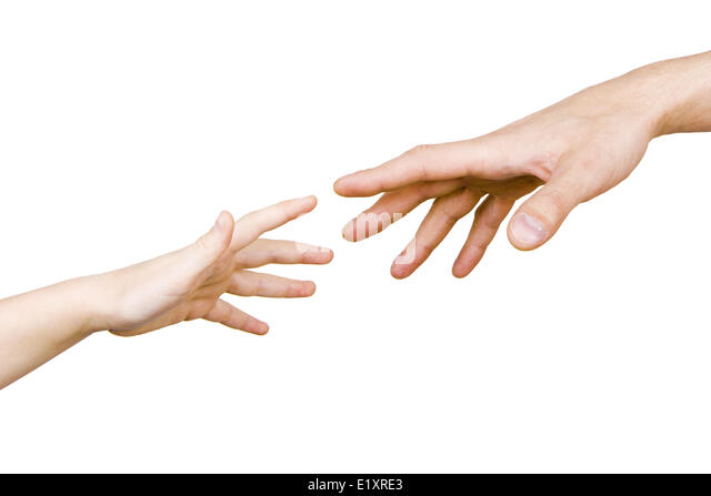 child's hand reaches for the men's hand - Stock Image