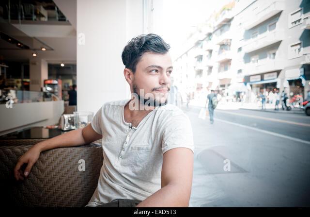 young stylish man sitting at the bar - Stock Image