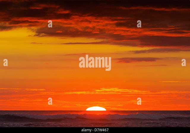 Sunset & sunlit clouds over Playa Guiones surf beach, Nosara, Nicoya Peninsula, Guanacaste Province, Costa Rica - Stock Image